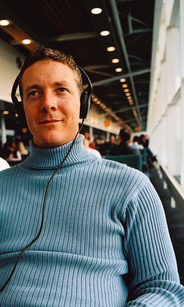 guy in turtleneck wearing headphones