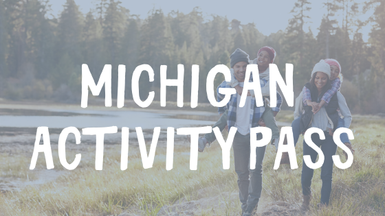 michigan activity pass with family hiking in the background